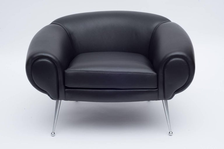An incredibly rare example of Illum Wikkelsø's work. The form is consistent with his other plush and luxurious leather furniture accented by the untypical sleek aluminium legs.