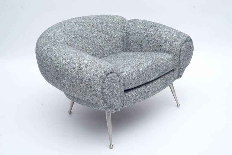 The form is consistent with his other plush and luxurious furniture of the period. There is also a sofa available in the same form. Upholstered in customers own material (C.O.M.).
