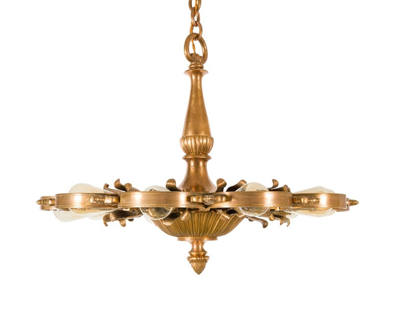 Outstanding chandeliers by the premier lighting manufacturer of the early 20th Century. There are four available. The measurement indicated for the height can be increased significantly if necessary with the original chain that is available.