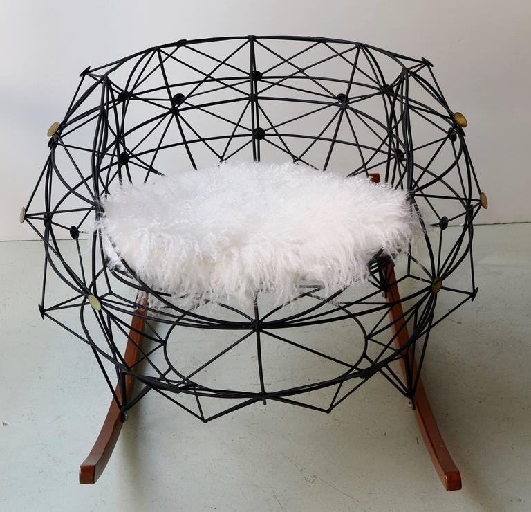 Functional art chair in powder coated wrought iron with brass insets and wooden legs by Baltasar Portillo, El Salvador, 2016. Inspired by the pattern of connecting stars in the sky within boundaries of what is known as the