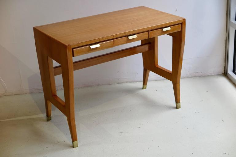 Pair of desks or tables in ash with three drawers and handles and feet in brass by Gio Ponti (1891 - 1971), Italy, circa 1940. The desks were at the Banca Nazionale del Lavoro in Bergamo, Italy. Comes with letter of authenticity from the Gio Ponti