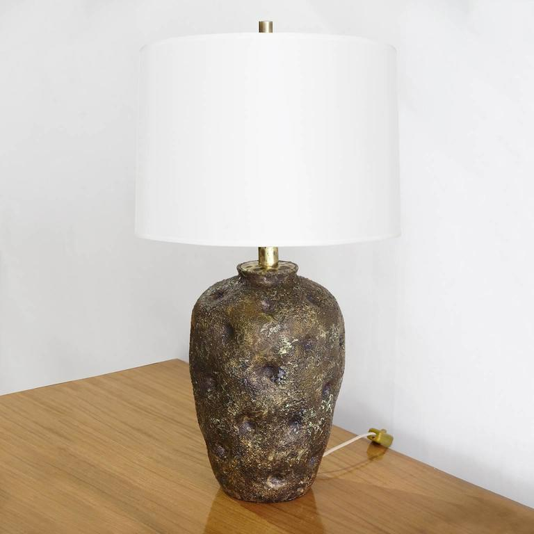 Italian Studio ceramic table lamp in brown with violet shades and gold glimmer by Marcello Fantoni (1915-2011) Italy, circa 1950. Signed: Fantoni, Italy, Lammerti. Newly rewired with double socket cluster.