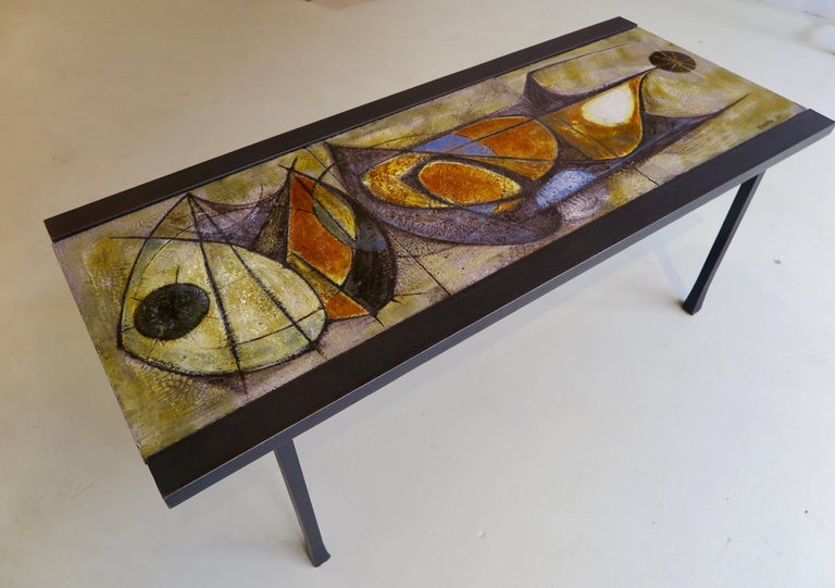 Unique ceramic coffee table with three distinctive painted ceramic tiles sitting on a rectangular iron frame by artist Pierre Saint-Paul, France, circa 1950.