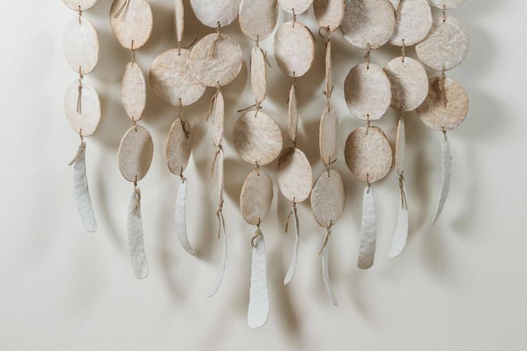 Ceramic wall hanging by MQuan Studio.