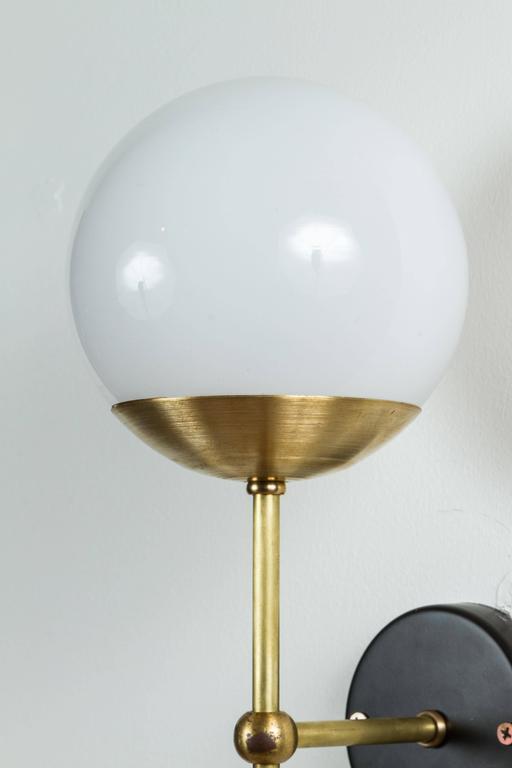 Single globe sconce by Lawson-Fenning.