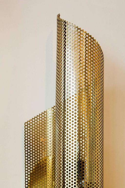 Brass rolled perforated sconce by Lawson-Fenning.