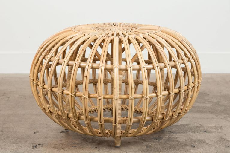 Small rattan ottoman by Franco Albini. Current production by Sika Design.
