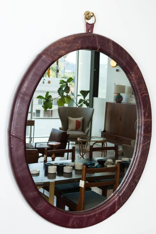Leather oval mirror by Jason Koharik for Collected By.