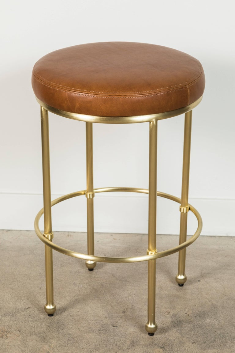 Orsini counterstool by Lawson-Fenning in leather and satin brass.  Available to order in customers own material with a 6-8 week lead time.  As shown: $1,455. To order: $1,325 + COM.