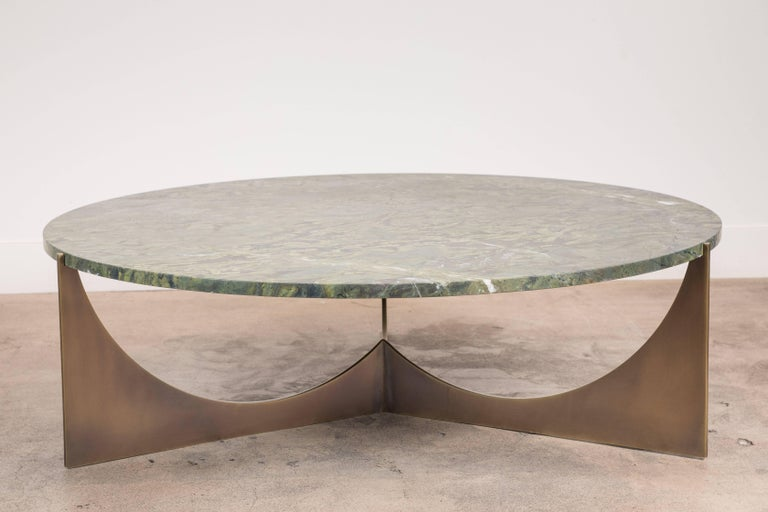 Eclipse coffee table by Ten10 in solid brass and green granite.