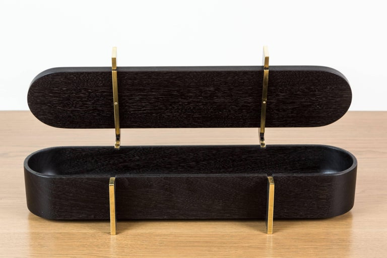 Ebonized Walnut and Brass Lidded Box by Artist Vincent Pocsik in collaboration with Lawson-Fenning. Features a sculptural carved wood interior. Made of natural materials, this decorative object can be accessorized on table top, book shelf, or desk