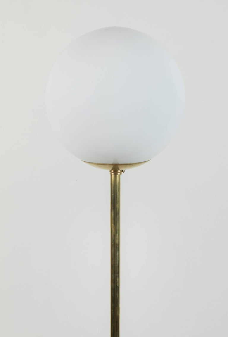 Moon pole floor lamp by Carly Jo Morgan.