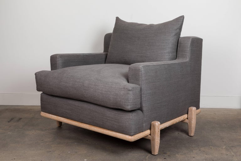 The George Chair is part of the collaborative collection with interior designer Brian Paquette. The George Chair is a low profile, but wide-scale lounge chair that rests on top of a solid wood base. This piece is available in exclusive BP for LF