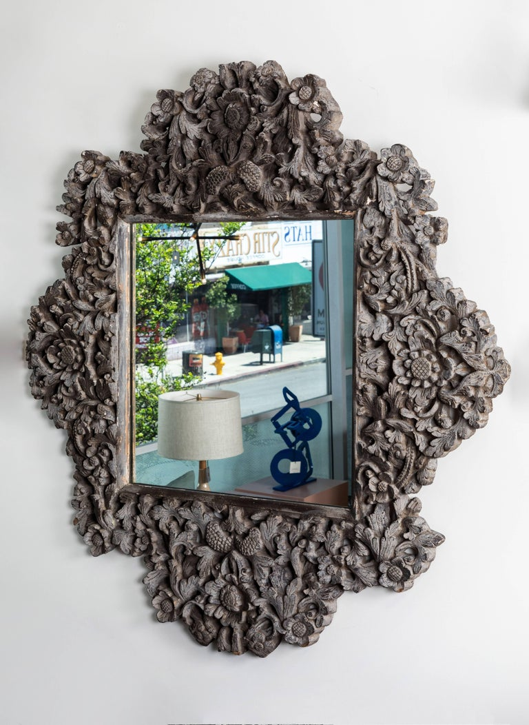 Vintage grey-painted cast-resin mirror by Tony Duquette.  Spanish Colonial style. Decorated with sunflowers and foliage From Duquette's personal office at his Dawnridge estate.