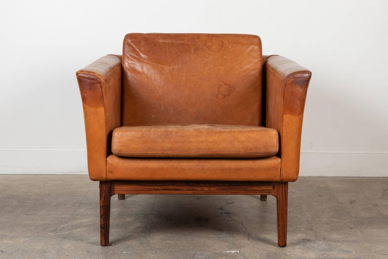 Vintage leather and rosewood chair by Arne Norell.