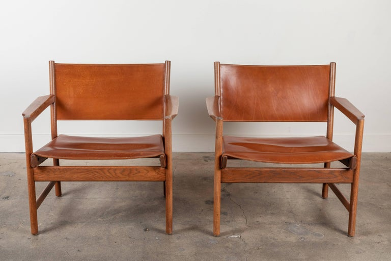 Pair of leather lounge chairs attributed to Gunnar Myrstrand.