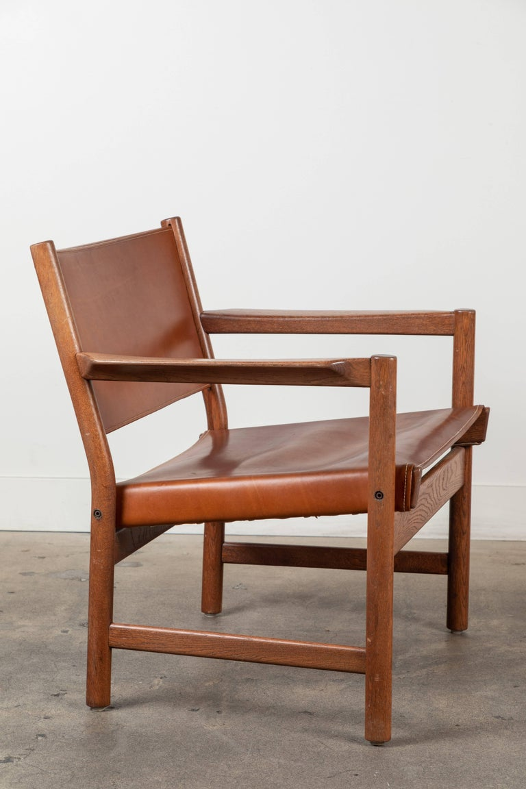 Swedish Pair of Leather Lounge Chairs Attributed to Gunnar Myrstrand For Sale