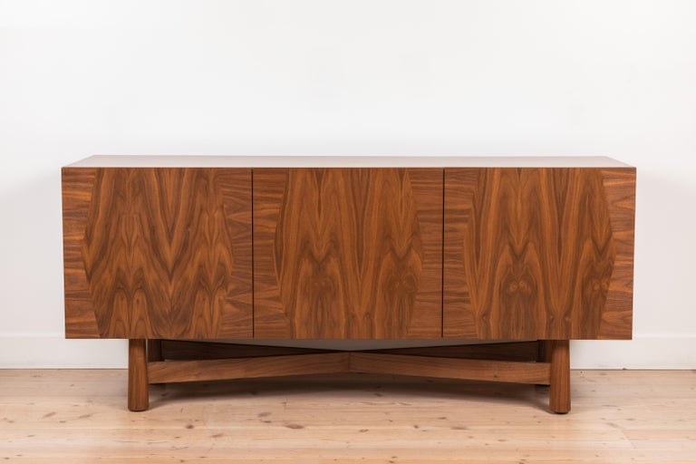 The 3-door Bronson cabinet has three drawers and three doors that feature a parquet detail on the front of the case. The cabinet can be made in American walnut or white oak. Shown here in light walnut.   Available to order in various finishes with