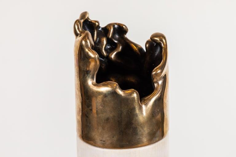 Cast bronze and bleached maple vase by Vincent Pocsik.