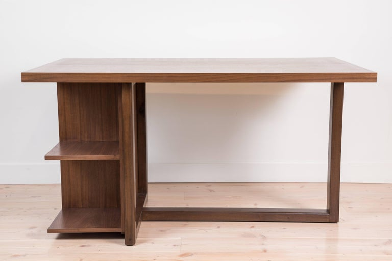 The Ivanhoe desk features a cantilevered base with open display shelves. Available in American walnut or white oak and drawers are available upon request.