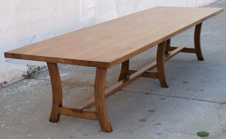 This six-legged dining table made from vintage walnut is seen here in 144