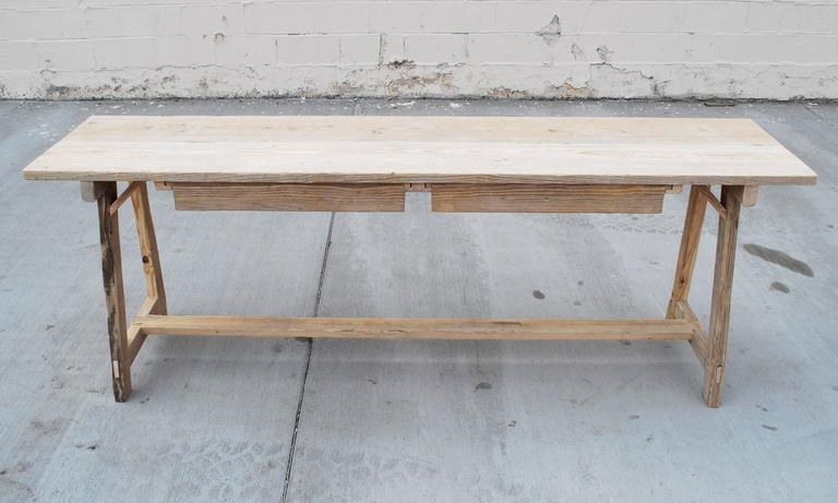 Primitive console table or sofa table in vintage fir with great patina. Legs are splayed in both length and width axis. Has two large drawers that can be pulled out from either side.  We build these tables, to order, in our Los Angeles workshop so