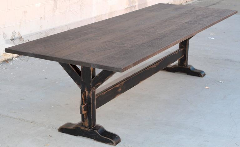 This nicely distressed trestle table has a painted base and is made from vintage walnut.  Because each table is bench-made in our own Los Angeles workshop you can influence all aspects of design, including size, wood specie and finish. We use only