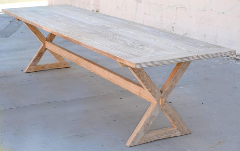 This trestle table is made from solid, reclaimed sun-bleached heart-pine. Lots of character and charm! The top can be taken off the base by pulling out the round pin at the top center of each leg, right under the table top. You can order any size up