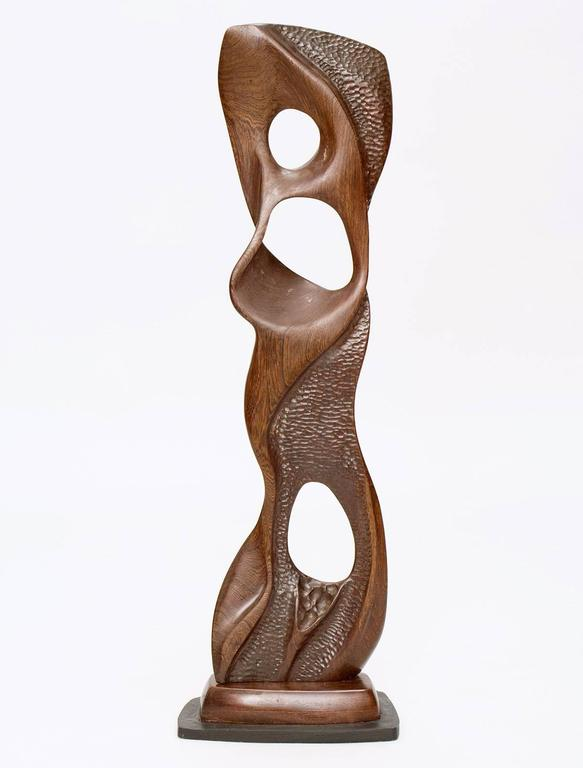 Expertly carved, biomorphic black walnut wood sculpture on artist's stand by acclaimed New Hope, Pennsylvania sculptor E. Newell Weber. The liquid-like piece is finely textured on one side and smooth on the other. Partially signed.