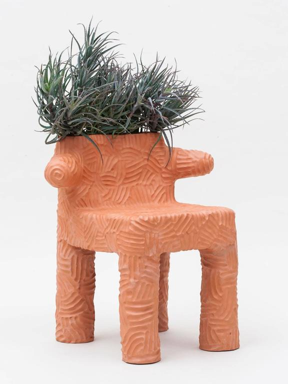 The Magdalena Plant Chair is hand-built out of terracotta ceramic clay and embedded with live plants. Works outside or indoors. Made to order with a lead time of 10-12 weeks.
