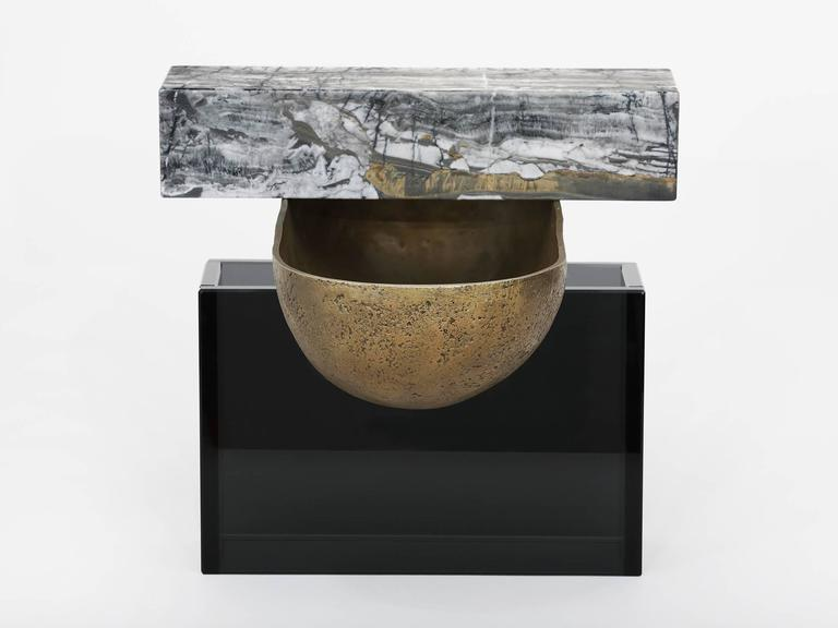 One of three vessels developed as the material maquette's for Brian Thoreen's larger works. Comprised of a cast bronze bowl, grey marble and grey glass. Also available in brown or red marble and bronze glass. Edition of 5 + I AP.