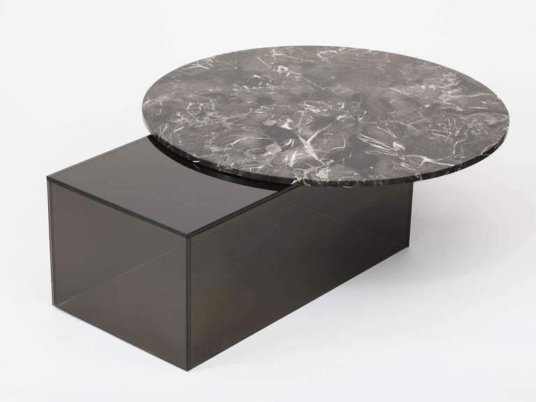 Shift coffee table by Los Angeles based designer Brian Thoreen. Made of brown marble and bronze glass. Custom material combinations available, including grey glass and red and grey marble. Edition of 8 + II AP.