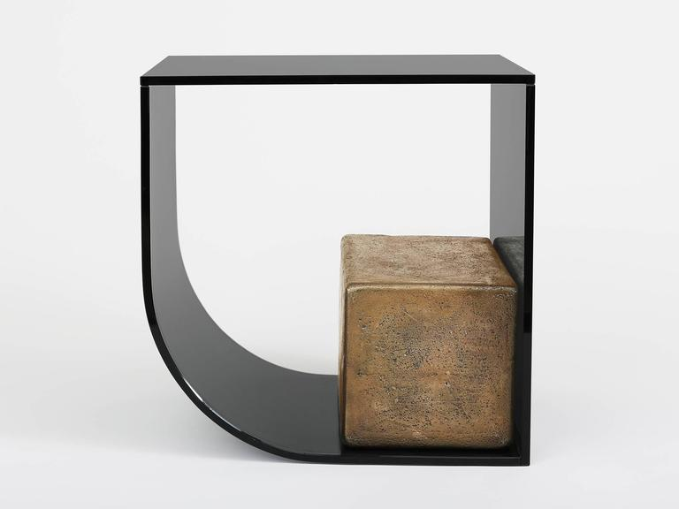 Side table by Los Angeles based designer Brian Thoreen. Made of curved grey glass and weighted upright by a cast bronze block. Also available in bronze glass. Edition of 8 + II AP.