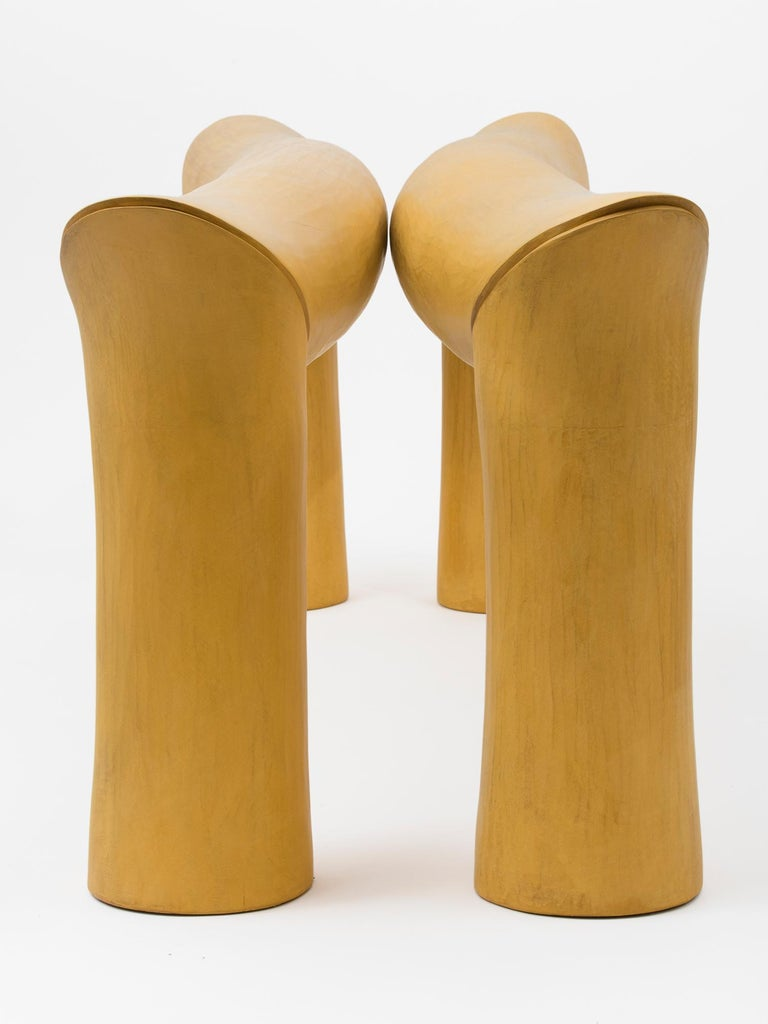 Large hand-carved tulipwood and yellow milk paint sculpture entitled,