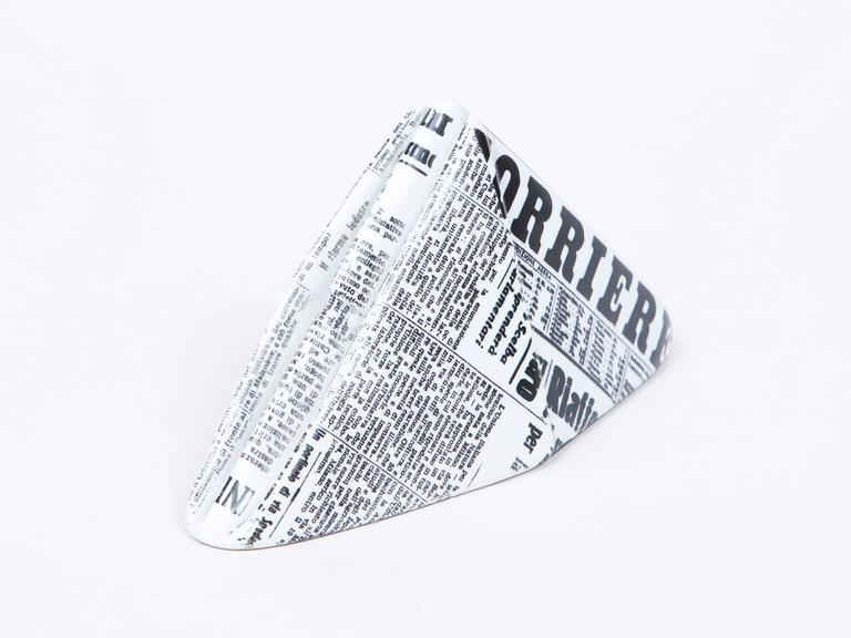 Porcelain paperweight in the form of a newspaper hat by iconic Italian artist Piero Fornasetti.