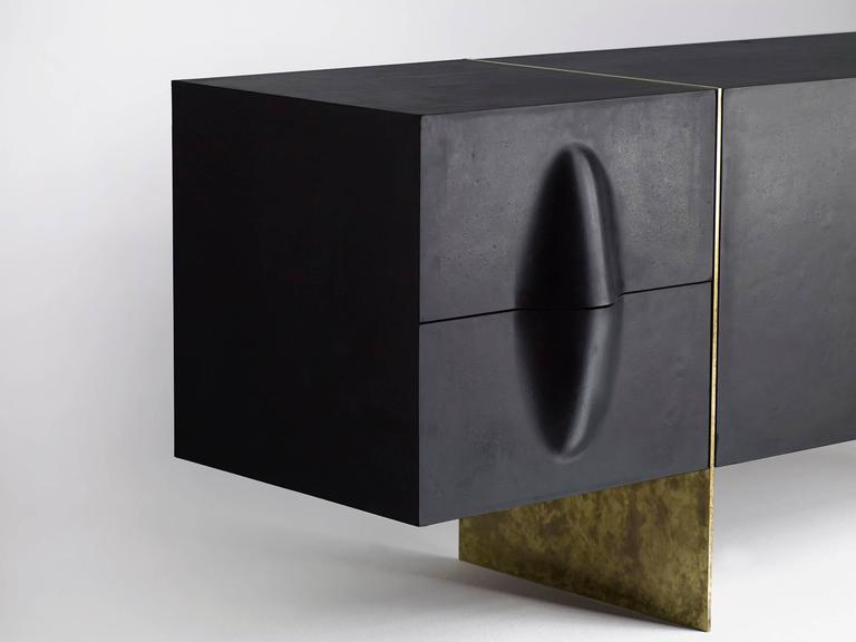Rubber and brass credenza with an aniline dyed wood interior by LA-based designer Brian Thoreen. Custom sizes and configurations are available.