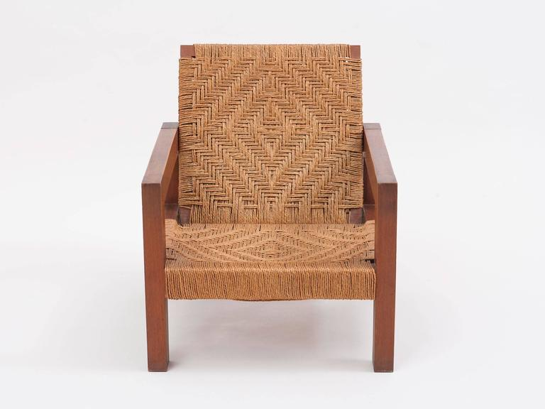 Woven Pair Of Indian Modernist Teak And Jute Lounge Chairs For Sale