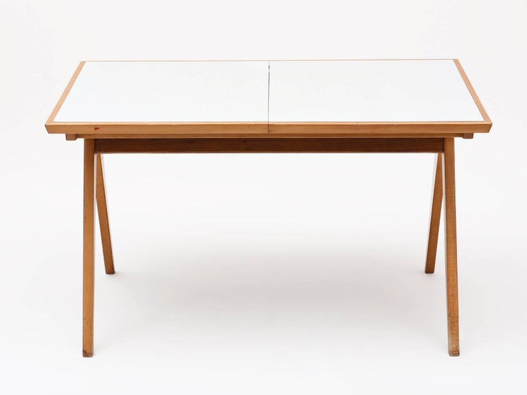 Rare maple and white laminate compass dining table or desk with hidden leaf by unheralded American designer Allan Gould. Manufactured by his company, Functional Furniture.