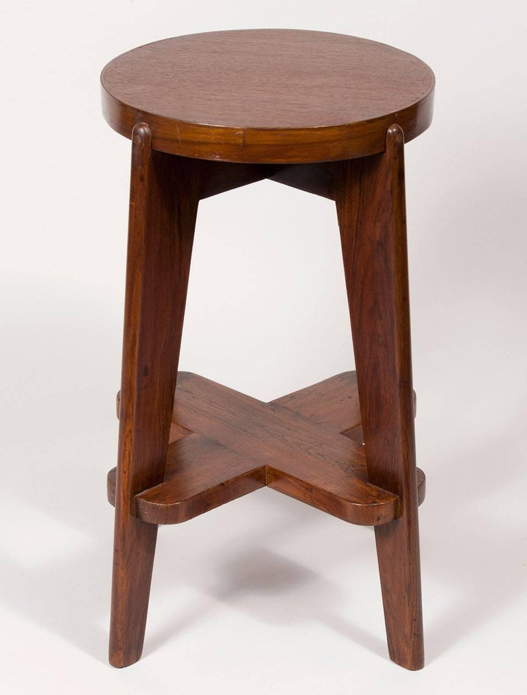 Solid Indian teak bar stool by the Swiss architect Pierre Jeanneret. The stool is an original from the Modernist city of Chandigarh, India, which he designed with his cousin Le Corbusier. In addition to its singular beauty, Jeanneret's Chandigarh