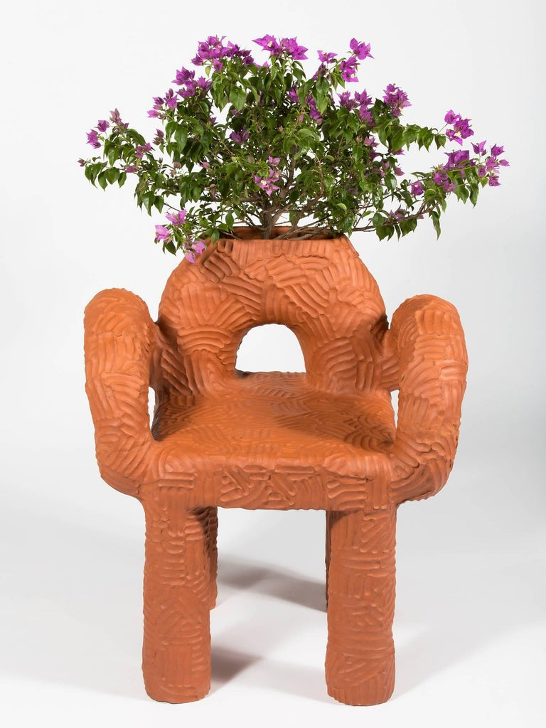 Large terracotta indoor/outdoor planter chair, handmade by New York and Medellín-based artist Chris Wolston.