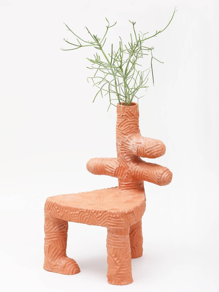Large terracotta indoor/outdoor planter chair, handmade by New York and Medellín-based artist Chris Wolston. Plant included. Made to order with a lead time of 6-8 weeks.