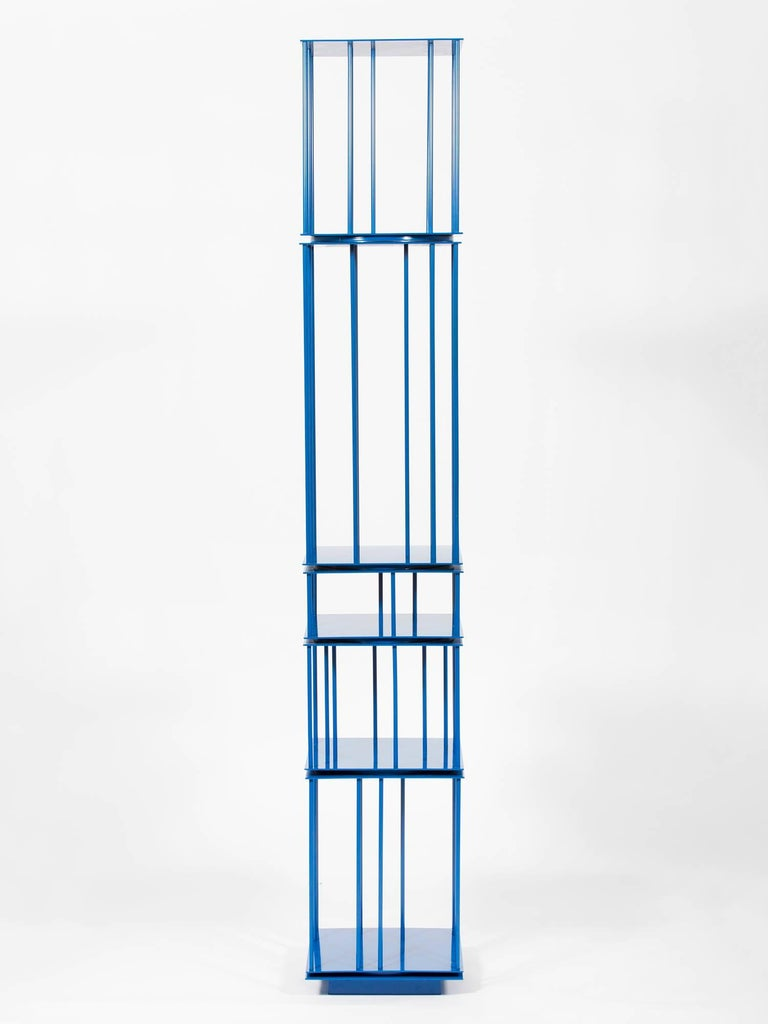 Elegant architectural tower in blue with rotating units, made in New York out of powder-coated steel. Founded by architect Harry Nuriev, New York and Moscow-based Crosby Studios strikes a balance between functionality/engineering precision and