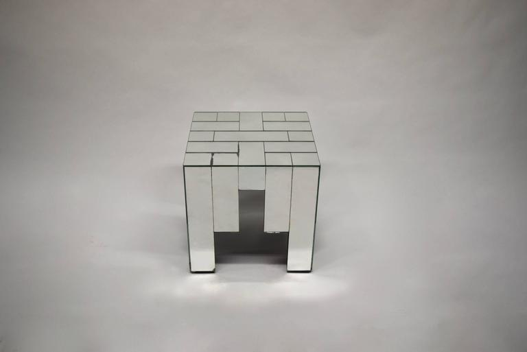 Pair of side tables made of rectangular and square pieces of mirrored glass applied over wood, designed by Jaques Grange manufactured and signed by Carl.