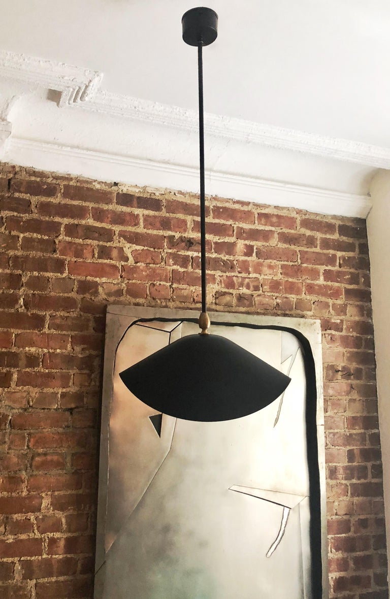Three ceiling lights in black and white enameled metal each has a 24 inch stem with an  articulating shade and a brass fitting. Designed by Serge Mouille in 1950's. All three lights were produced in France 2005. Priced per Light!!