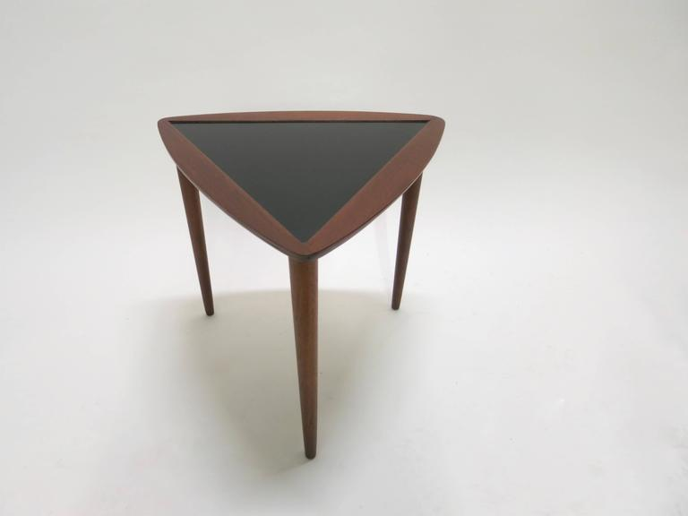 Three Triangular Stacking Tables Have An Inset Black Laminate Top Framed In  Walnut Each With Three