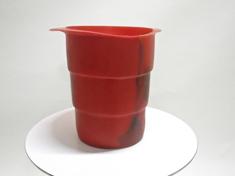 Ice bucket and decorative object by Gaetano Pesce made by Fish Design, in a red colored Soft Resin with a dark color mixed in through out.  Single owner who purchased from Artist in the 1990's NYC.