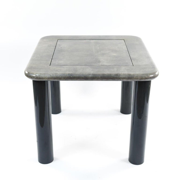 Italian goatskin and black lacquer game table. Top reverses into backgammon board. Measures: 28.5