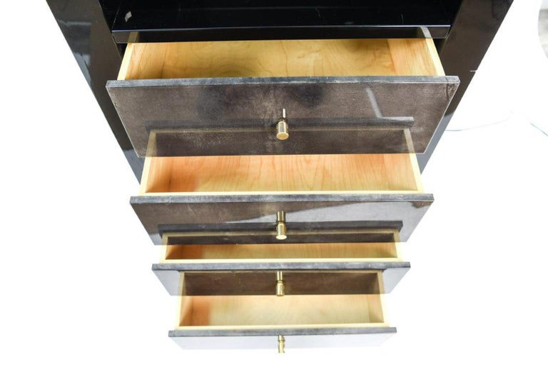 Italian goatskin and lacquer étagère cabinet with one glass shelf and four drawers. Measures: 86.5