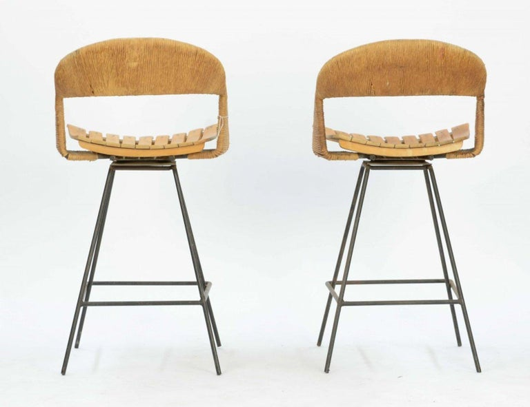 A pair of iron, wood and jute bar stools by Arthur Umanoff.