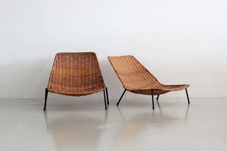 Unique pair of woven wicker pool chairs with iron base in the style of Carlo Graffi. Great scale and low to the ground. Perfect for lounging by pool or perhaps a kids room!